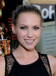 Laura Ramsey paired her lace jumper with a loose bun.