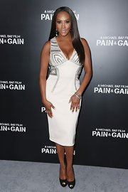 Vivica A. Fox chose a white and silver fitted dress for a sexy red carpet look at the premiere of 'Pain & Gain.'