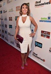 Kelly Dodd put her assets on display in a white cutout dress at the premiere party for 'The Real Housewives of Orange County.'