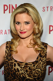 Holly Madison showed off her golden locks with tight ringlet curls.
