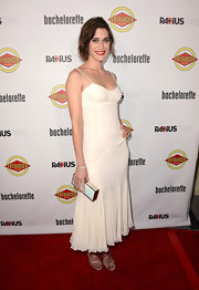 Lizzy Caplan looked sweet and sexy in this ivory corset dress with lovely godets.