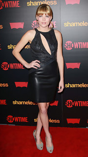 Emma paired her daring LBD with taupe peep-toe pumps.