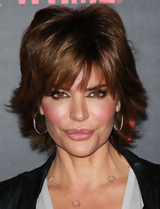 Lisa Rinna attended the premiere reception for 'Shameless' wearing her hair in a cute layered razor cut with sexy lash-grazing bangs.