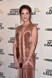Katie Holmes arrived for the premiere of 'The Kennedys: After Camelot' carrying a chic gold clutch by Lee Savage.