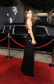 Olivia Wilde added a touch of the exotic to her sultry black gown with an animal print knuckle duster clutch.