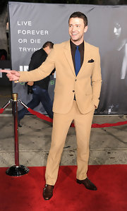 Justin Timberlake stood out on the red carpet in a dapper cream suit with a navy tie and brown button-down shirt.