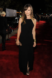 "Olivia Wilde added drama to her sexy black dress with black suede ""Salbourg"" platform heels, complete with a tasseled ankle wrap."