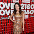 Long Wavy Cut Lookbook: Hayley Orrantia wearing Long Wavy Cut (5 of 5). Soft waves gave Hayley Orrantia a glamorous red carpet look at the '21 and Over' red carpet.