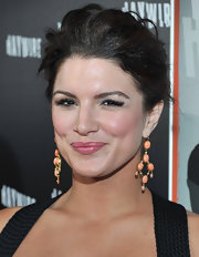 Gina Carano wore a pair of dangling peach earring on the 'Haywire' red carpet.