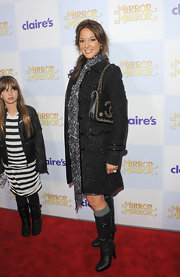 Eva la Rue paired a patterned scarf with a tweed coat for a sophisticated finish at the premiere of 'Mirror Mirror.'