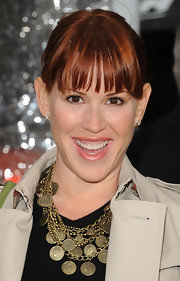 Molly Ringwald pulled her hair back in an updo but kept her bangs down for a chic and youthful look.