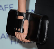 Cobie looked totally cool and biker chic when she carried this black leather clutch.