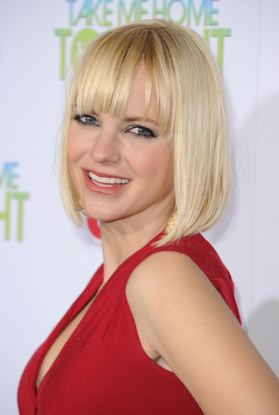 Anna keeps it cute and sassy with a platinum blond bob and piecey bangs.