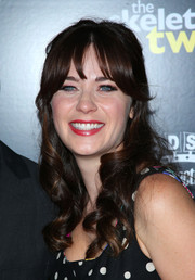 Zooey Deschanel styled her hair into a half-up 'do with curly ends for the premiere of 'The Skeleton Twins.'