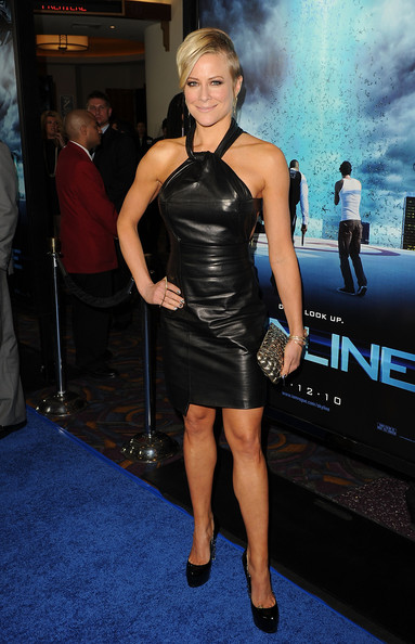 Brittany shows off her fit figure in this little black leather dress.