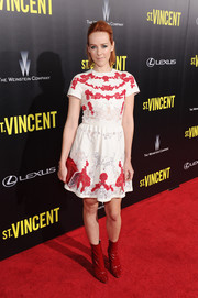 Jena Malone went for cool styling with a pair of red patent ankle boots by Tamara Mellon.