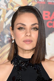 Mila Kunis accessorized with a lovely pair of dangling diamond earrings.