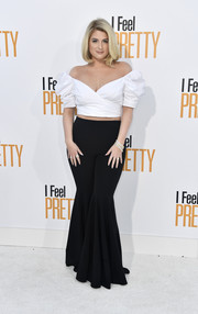 Meghan Trainor was flirty and cute in a cropped off-the-shoulder top with puffed sleeves at the premiere of 'I Feel Pretty.'