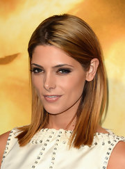 Ashley topped off her glowing look with a shiny flesh-toned lip color.
