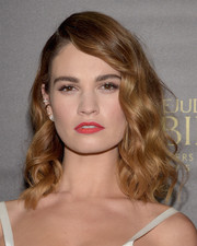 Lily James chose a bright red hue for her lips.