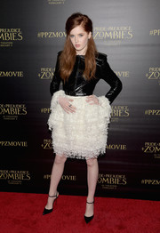 Ellie Bamber attended the premiere of 'Pride and Prejudice and Zombies' wearing a black patent leather jacket by Chanel Couture.
