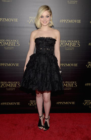 Bella Heathcote was feminine and flirty in a strapless black lace dress by Dolce & Gabbana at the premiere of 'Pride and Prejudice and Zombies.'