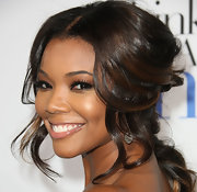 Gabrielle Union wore her hair in a lovely half-up, half-down 'do with shiny loose curls at the premiere of 'Think Like a Man.'