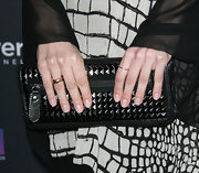 "Eliza Dushku made an edgy appearance at the ""Life"" premiere donning a black studded clutch."