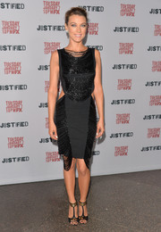 Natalie Zea teamed her dress with gold and black T-strap sandals for a totally chic look.