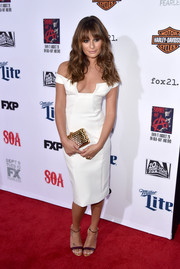 Lea Michele polished off her ensemble with a metallic gold clutch by Reece Hudson.