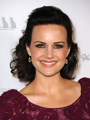 Actress Carla Gugino attended the premiere of her new film 'Girl Walks Into a Bar' wearing 18-karat gold and white topaz pear shaped Artigli earrings with diamonds.