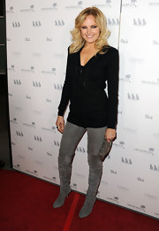 Malin Akerman hit the premiere of 'Girl Walks Into a Bar' in gray suede over the knee boots.