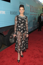 Carla Gugino put on a daring display in a sheer black floral frock by Antonio Marras at the premiere of 'Roadies.'