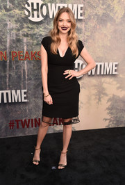 Black Stella Luna sandals with gold hardware completed Amanda Seyfried's simple yet chic look.