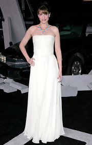 Amanda is breathtaking in this floor length white chiffon gown paired with a turquoise and gold necklace.