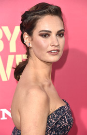 Lily James looked youthful and stylish wearing this twisty ponytail at the premiere of 'Baby Driver.'