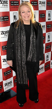 Jacki dons a long black scarf with fringed ends and a studded design for the 'Animal Kingdom' premiere in Los Angeles.