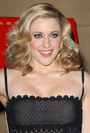 Greta Gerwig channeled Barbie with this shiny, high-volume curly 'do at the premiere of 'Damsels in Distress.'