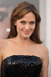 Angelina Jolie plays up her dramatic blue eyes with dark lashes and neutral eyeshadow.