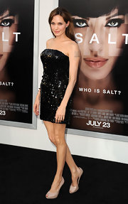 Angelina paired her sparkling LBD with nude, peep toe pumps.