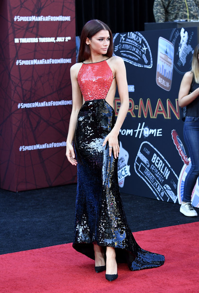 Zendaya Coleman looked fierce in a red and black sequined gown with an open back at the premiere of 'Spider-Man: Far From Home.'