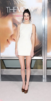 Kendal Jenner paired her mini dress with bronzed platform pumps.