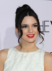 Kendall Jenner wore her raven tresses in a high classic bun with pretty face-framing tendrils at the premiere of 'The Vow.