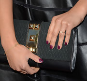 Shay Mitchell topped off her edgy red carpet look with a black clutch with gold stud detailing.