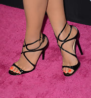 Shay Mitchell showed off her orange pedicure with these black strappy sandals.