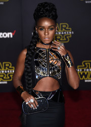 Wearing a pair of gold cuffs with her mirror-embellished outfit, Janelle Monae looked like she just stepped out of the movie itself!
