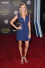 Kelly Rohrbach put on a sultry display in a blue mini dress with a plunging neckline and side cutouts at the 'Star Wars: The Force Awakes' premiere.