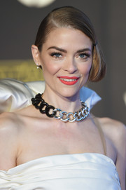 Jaime King sweetened up her look with a bright coral lip.
