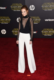 Darby Stanchfield paired her blouse with on-trend flared pants.