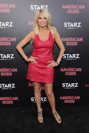 Kristin Chenoweth styled her dress with bejeweled T-strap sandals by Gucci.